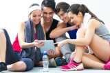Group of fitness people looking at a tablet
